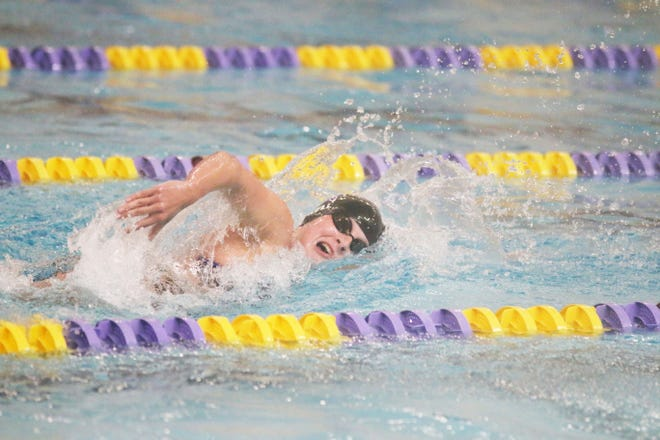 Mallory Kell swims in a meet earlier this season.