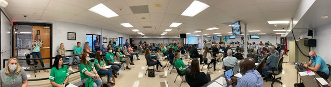 Teachers and parents from McDowell Elementary School attend a meeting of he Maury County Board of Education sporting the school's official color as the board prepares to vote on a plan to close the campus during a meeting at Horace O. Porter School in Columbia, Tenn., on Tuesday Sept. 8, 2020.