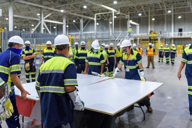 EGGER laminated the first particleboard panel at its new manufacturing facility in Lexington.