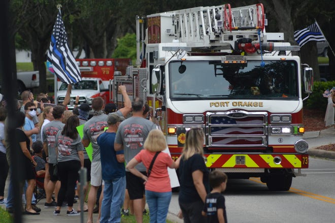 Port Orange police and firefighters protest outside City Hall on Wednesday in an effort to pressure City Council members to leave room in the budget for pay negotiations and better benefits.