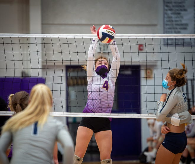 Blue Springs' Chloe Kaminski leaps to stop a Lee's Summit West attack during the Wildcats' four-set win Tuesday at home.