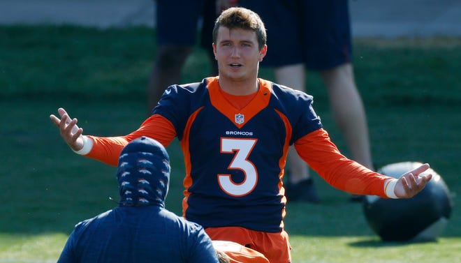 Denver Broncos quarterback and Lee's Summit native Drew Lock takes part in drills during NFL football practice at the team's headquarters in August in Englewood, Colo.