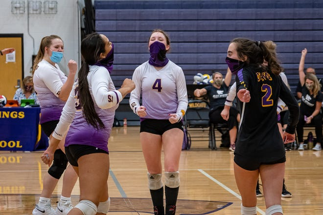 The Blue Springs Wildcats celebrate the match-clinching point as they beat Lee's Summit West in four sets at home Tuesday.