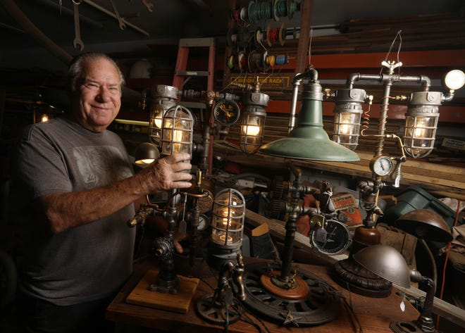 Artist Rick Huff is shown Sept. 4 in his studio amid some of his industrial-inspired lamps in Fort Madison.