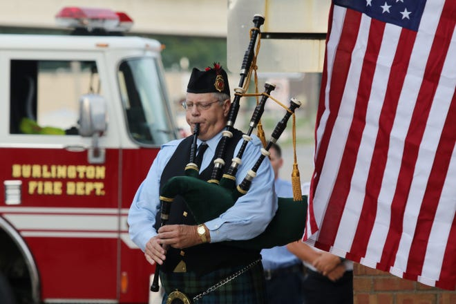 Burlington Fire Department Retired Deputy Chief Gene Wilkerson plays Amazing Grace on the bagpipes during the 2019 9/11 Remembrance Ceremony at the Central Fire Station in Burlington. This year the Burlington Fire Department will host a virtual 9/11 Remembrance Ceremony live on Facebook only, due to the coronavirus.