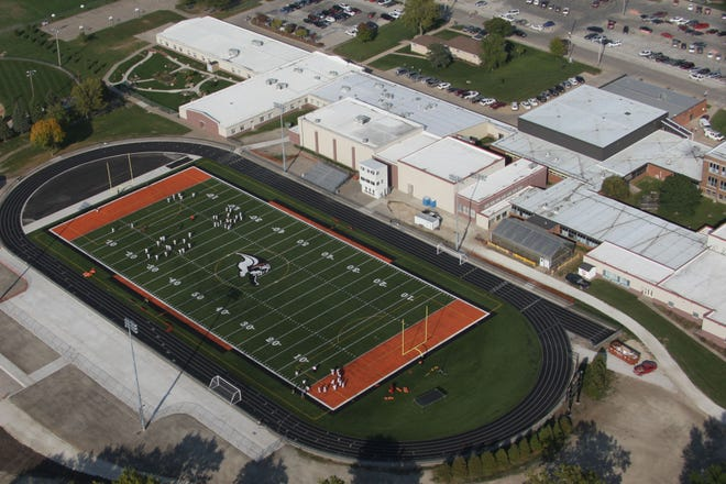 Players practice on the football field at Mediapolis High School in Mediapolis. Voters in the Mediapolis School District on Tuesday cleared the way for the district to continue collecting up to 67 cents per $1,000 taxable valuation for the next 10 years.