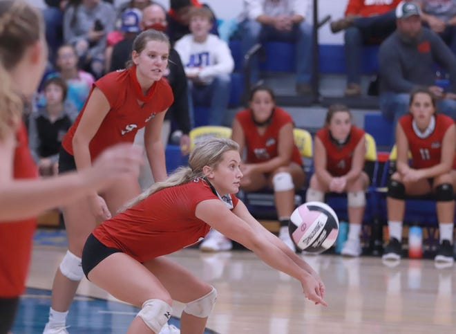 Winfield-Mount Union High School's Jami Wilkerson gets a dig during Tuesday night 3-0 sweep over Wapello as Jenna Buffington (9) looks on.