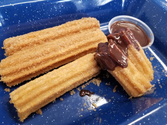 Churros with an accompanying Nutella dip ($2.50) offer a hot and sweet finish to your meal. Take a bite to find a gooey custard hidden inside.