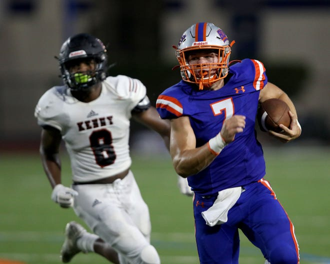 Bolles quarterback Gunner Boree (7) eludes Bishop Kenny linebacker Miles Cameron (8) during Friday's football scrimmage.