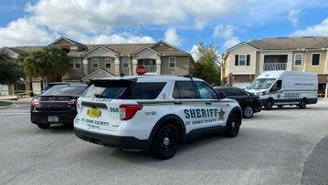 St. Johns Sheriff's Office investigators work at Wednesday's shooting scene.