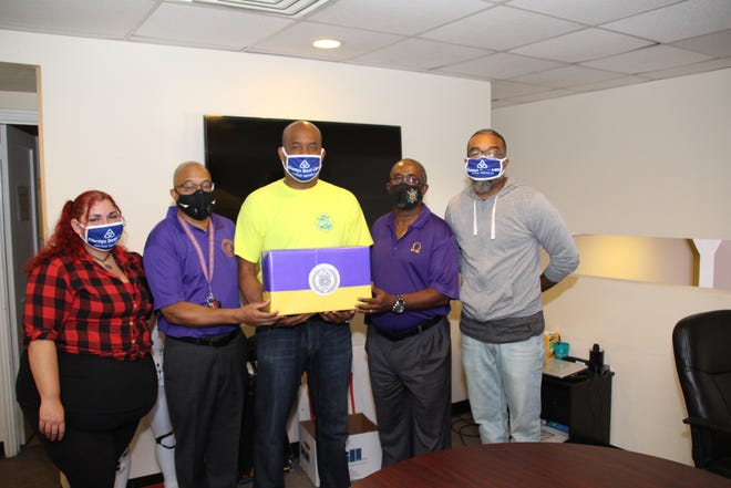 Members of the Corridor 3 COVID-19 Response Team of the Omega Psi Phi fraternity recently donated 300 protective face masks to Always Best Care Senior Services of Philadelphia, Bucks, Delaware, Montgomery Counties and the Main Line and Always Best Care Delaware, for the company's direct-care workers providing care for in-home clients. From left, Margaret Mason, human resource assistant with Always Best Care; Harrison Potts, fraternity corridor representative; Bryant M. Greene, founder and owner/administrator of Always Best Care and a member of the fraternity; Tony Jones, fraternity representative; and Allen LeGere Jr., customer service manager with Always Best Care.