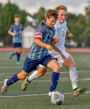 Hudson captain Peter Strawbridge runs by a Lake defender during a game earlier this season. Strawbridge had a goal and an assist in Hudson's 7-1 win at Brecksville-Broadview Heights Sept. 8.