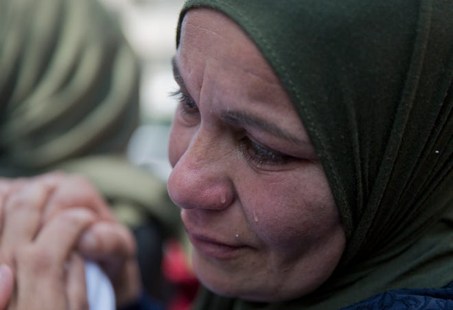 A relative of Palestinian Ahmad Manasra cries during his March 2019  funeral in the West Bank village of Wad Fokin, near Bethlehem. In August, Israeli military prosecutors offered three months of community service to a soldier who shot and killed Manasra, an unarmed Palestinian man who exited his vehicle to assist a second motorist who had also been shot — in a case that has drawn renewed attention to a justice system that Palestinians and human rights activists say has created an atmosphere of impunity. The deal is now being reviewed by the Israeli Supreme Court.