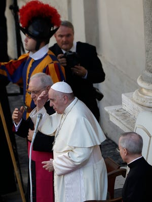 Pope Francis makes the sign of the cross during his weekly general audience general audience in San Damaso courtyard at the Vatican on Wednesday.