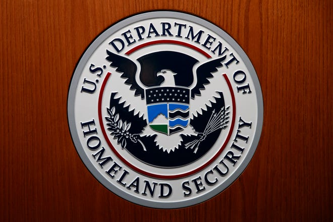 An official at the Department of Homeland Security said he was pressured by agency leaders to suppress details in his intelligence reports that President Donald Trump might find objectionable, including intelligence on Russian interference in the election and the threat posed by white supremacists.