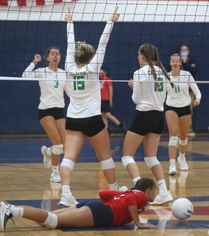 Choctaw players celebrate a point during their volleyball match at Fort Walton Beach Tuesday. The Lady Indians swept the Lady Vikings.