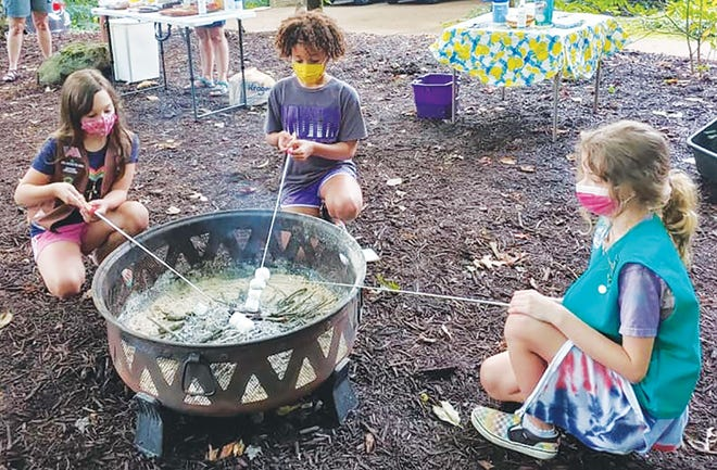 Girl Scouts of all ages roast marshmallows on National S'Mores Day, Aug. 10.