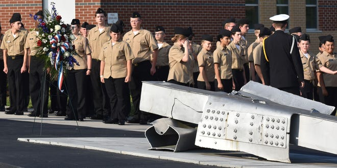 Naval Junior Reserve Officers Training Corps students attend a previous memorial service for the Sept. 11, 2001 victims on Sept. 11, 2019. The steel pictured is from the wreckage of the World Trade Center, which the hijackers destroyed in that attack