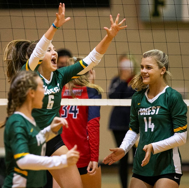 Forest's (6) Kailyn Howard celebrates a point in the third set. The Wildcats defeated the Vanguard Knights in straight sets Tuesday night.