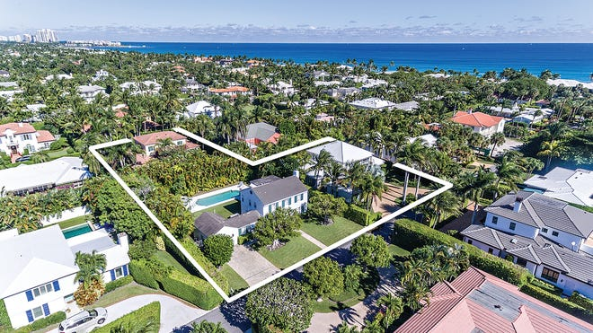 A photo with an added white perimeter line shows three adjacent houses that just sold for a recorded $10.975 million in Palm Beach. In the foreground are 233 and 253 El Pueblo Way. At the left with the red roof is 236 La Puerta Way. [Photo by Giles Bradford,  photo illustration courtesy Brown Harris Stevens]