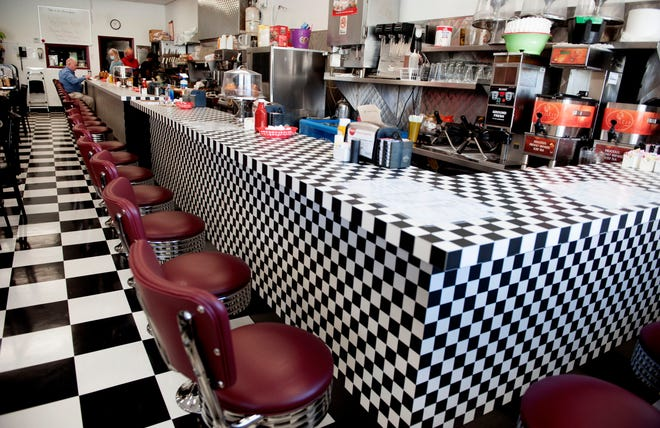 Green's Pharmacy Luncheonette, with its cozy tables and checkerboard lunch counter, is open today. It's open 365 days a year, unless a hurricane gets in the way.