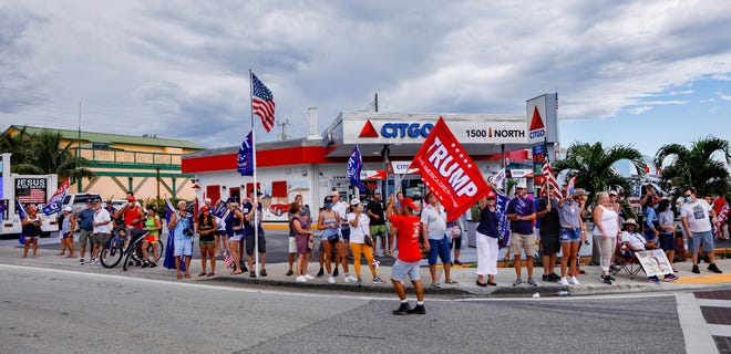 Donald Trump supporters wait at the intersection of A1A and Beach Rd. for the President Donald Trump's motorcade to leave the area, September 8, 2020.