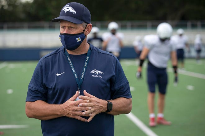 American Heritage athletic director Laney Stearns is pictured at Wednesday's practice. He promoted Brian Sheridan, not pictured, from defensive coordinator to head coach last season.