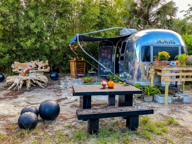 Sydney Jacobson and Johnathon Pezzino run The Lokomotive coffee micro lounge, seen here last year when it was housed in a classic 1971 Airstream Safari trailer at 312 Center Street.  [RICHARD GRAULICH/palmbeachpost.com]
