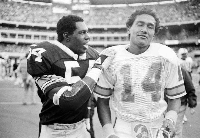 Tampa Bay quarterback Jack Thompson is consoled by Pittsburgh's Craig Bingham after the Steelers won 17-12 in 1983.