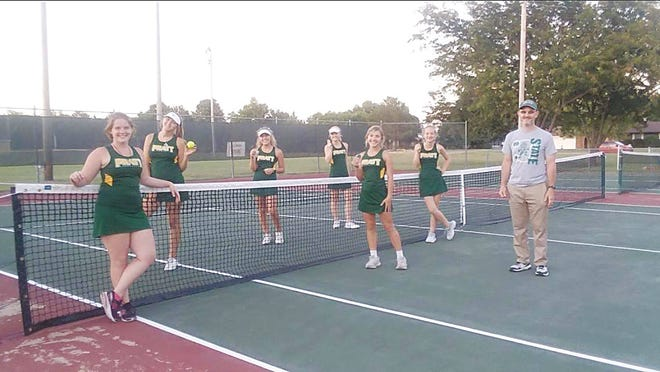 Lady Greenbacks tennis team show medals they won in their first competition of the fall season. (From left) Bella Barker, Hannah Holmes, Karsyn Sharp, Erin Jackson, Kena Sterling, Bailey Jackson and Coach Tate Thompson represented Pratt High School at Hillsbor and Sterling tournaments this past week.