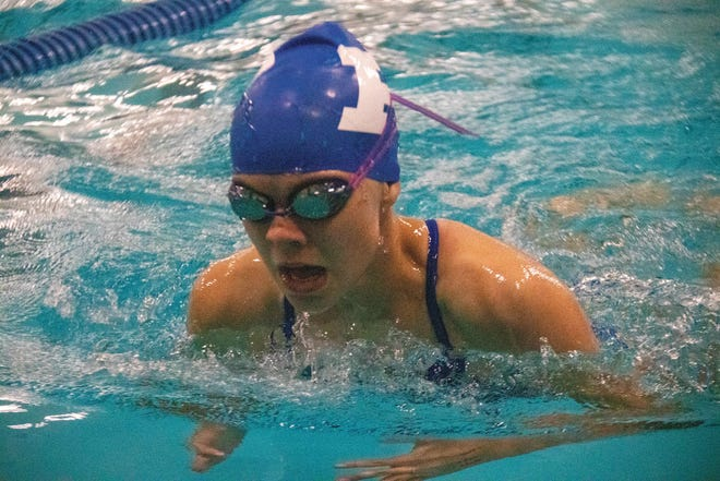 Jaylene Karolus competes during a home meet earlier this season. The junior broke the school record in the 100 freestyle with a time of 57.59 seconds on Tuesday, Oct. 6.
