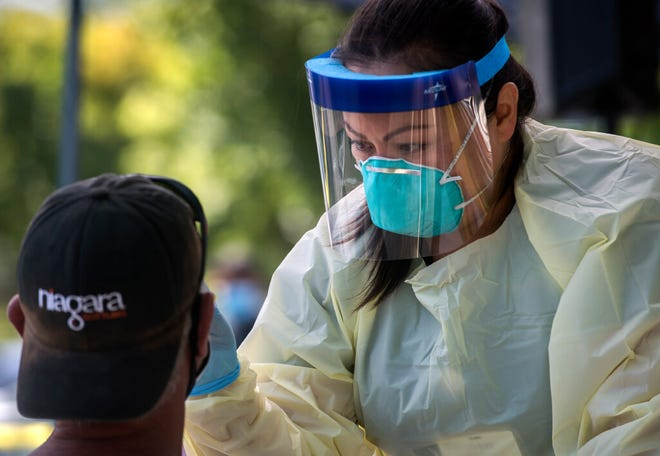 Registered nurse Katrina Nguyen with Community Medical Centers performs a COVID-19 test at a free testing site earlier this year in Lodi. Free pop-up COVID-19 tests will be available from 2 p.m. to 5 p.m. Friday Nov. 13 at Lincoln Center and from 2 p.m. to 4 p.m. Saturday at Woodbridge Crossing in Lodi.