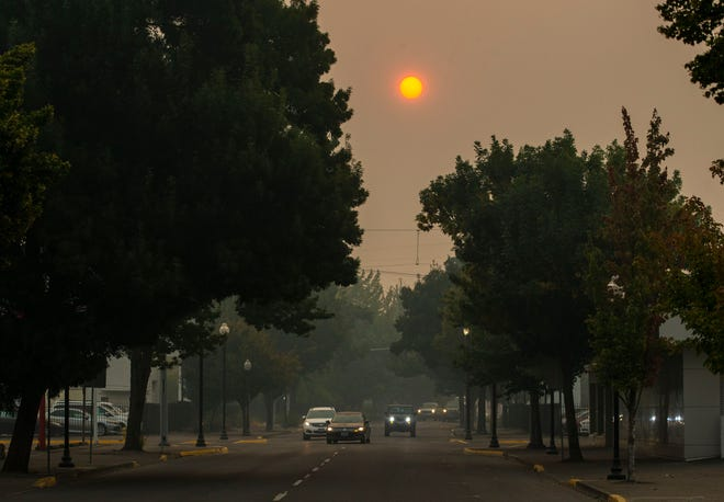 The sun glows in the smoke-filled sky over Main Street Springfield, Oregon on September, 9, 2020. Air quality in the region continues to categorized as extremely unhealthy due to smoke from area fires.
