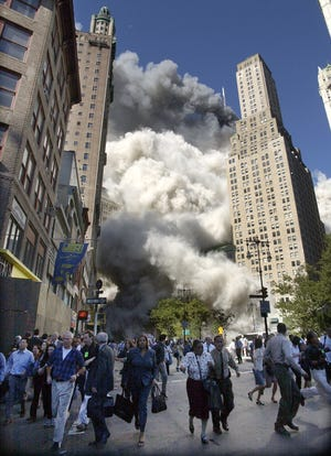 People flee the falling South Tower of the World Trade Center on Sept. 11, 2001.