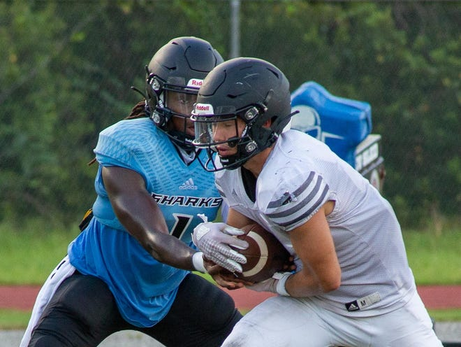 Ponte Vedra quarterback, Cobi Myers, left, and running back Campbell Parker, right, are seniors who have returned after significant leg injuries in 2019. Myers tore his Achilles eight plays into the season. Parker tore two ligaments in his ankle in late September. [Will Brown/The Record]