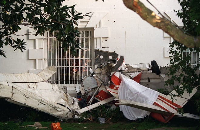 The wreckage of a small single-engine plane lies next to the South Portico near the Rose Garden at the White House on Sept. 12, 1994. The plane pierced the restricted zone around the White House, crashing near the mansion and killing the pilot.