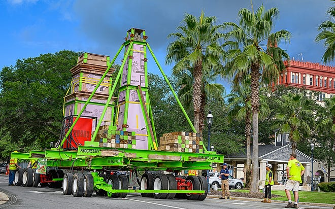 Workers move St. Augustine's Confederate monument from the Plaza de la Constitucion down King Street to the city's bayfront on Wednesday. The two sections of the memorial will be loaded on a barge from the bayfront Thursday and taken up the Intercoastal Waterway and down the St. Johns River to Trout Creek Fish Camp on State Road 13 in western St. Johns County.
