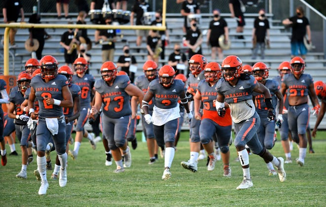 The Sailors run onto the field to start the game. Sarasota High hosted North Port High Friday night, Sept. 4, 2020, in the first football game of the school year. The Sailors opened the season with a win over the Bobcats and play host to Charlotte High on Friday.