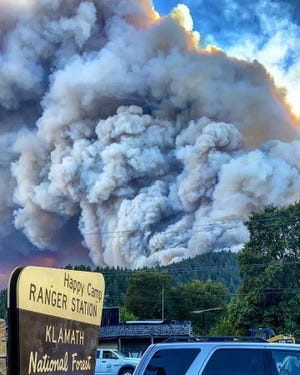 Smoke billows from the Slater Fire from the U.S. Forest Service's Ranger Station in Happy Camp at about 11 a.m. on Tuesday, Sept. 8, 2020.