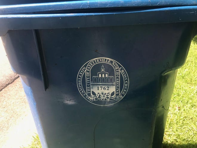 The Fayetteville City Council wants the controversial Market House logo off trash cans but has rejected spending nearly $3 million to replace them immediately.
