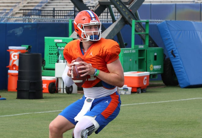 Florida quarterback Kyle Trask tries his hand with game plans.