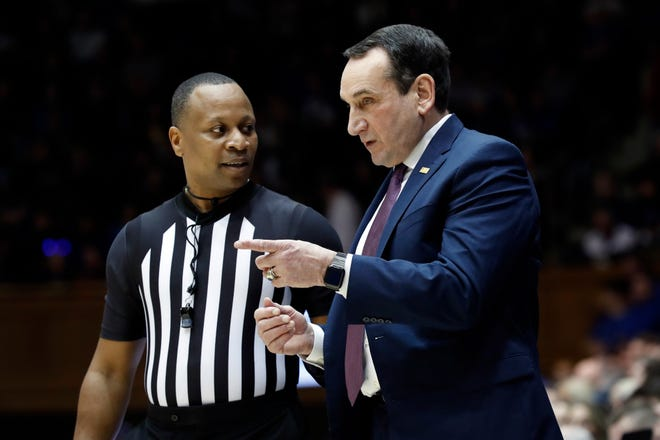 Duke coach Mike Krzyzewski, right, makes a point with official Michael Stephens during a February blowout of Notre Dame at Cameron Indoor Stadium.