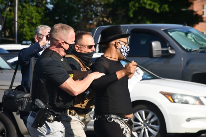 Deputies arrest Nicholas Cassette at a demonstration on Tuesday at the Alamance County Jail. (Photo by Dean-Paul Stephens/Times-News)