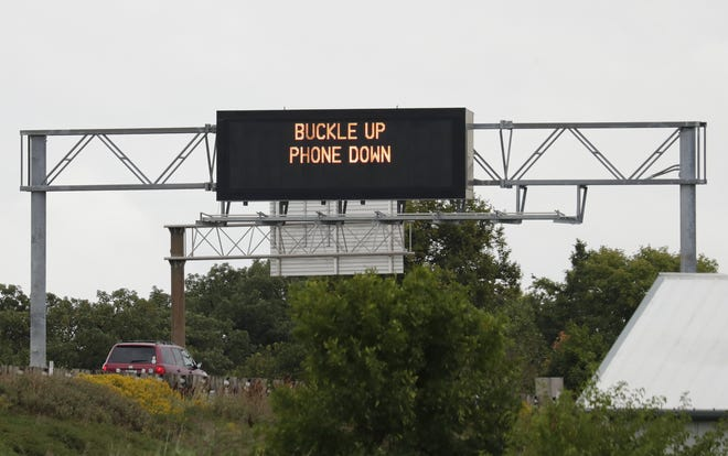 """A """"Buckle up, phone down"""" safety message greets motorists on northbound Interstate 41 near Winchester Road in Fox Crossing."""