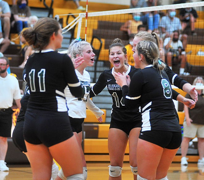 Smithville celebrates after scoring against Waynedale. It had plenty of reason to celebrate after scoring a thrilling five-set win over the Bears on the road.