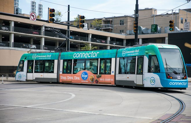 The Cincinnati Bell Connector makes a turn onto Second Street to Walnut Street in downtown Cincinnati, Sunday, Sept. 6, 2020. After a lot of discussion amongst council members in City Hall, the streetcar is now free. The streetcar launched four years ago on Sept. 9, 2016 and so far hasn't lived up to expectations.