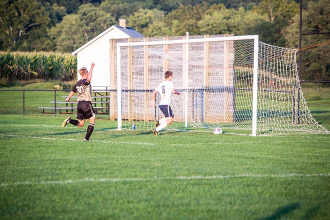 Senior Jordan Bryant celebrates as he finds the back of an empty net during the Black Bears match agianst Morgan on Tuesday night.