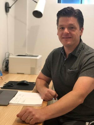 Adam Robinson, CEO of Hireology Inc., a Chicago-based HR technology provider, in his home office Sept. 2020. Robinson said he will allow his 200 employees flexibility to do remote work even post-pandemic.