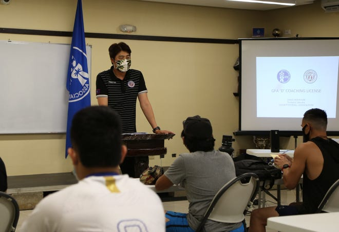 "Guam Football Association Technical Director and coach education instructor Sang Hoon Kim addresses course participants in a GFA ""D"" Coaching Certificate Course at the GFA National Training Center Lecture Hall in this file photo."