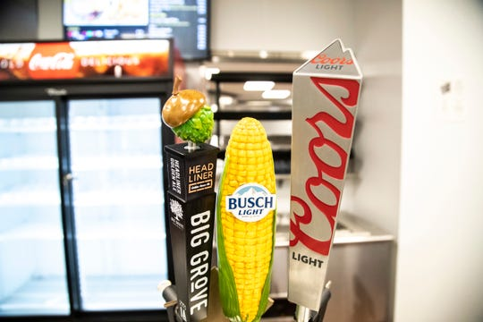 Taps of Big Grove Headliner golden ale, Busch Light and Coors Light are seen in a concessions area during a media tour, Wednesday, Sept. 9, 2020, at the Xtream Arena in Coralville, Iowa.